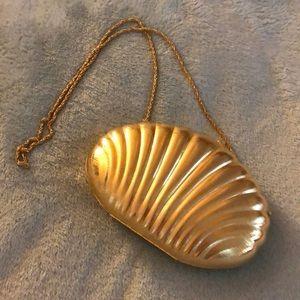 Gold shell evening bag . Black velvet lining.
